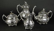 Four (4) Piece Continental Silverplate Repoussé Tea Service. Very Ornate with Eagle Finials. Signed with Hallmark as well as a flower shape. The Set includes: Coffee Pot, 10 Inches Tall; Tea Pot, 7-1/2 Inches Tall; Cream Pitcher, 7-1/2 Tall; Lidded
