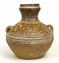 Han Dynasty (206 BCE-220 BC) Small Earthenware Hu Vessel with Lug Handles. Surface Wear and Cracks Consistent with Age Otherwise in Good Condition. Measures 5-1/4 Inches Tall, 5-1/2 Inches Wide. The Gallery Has Been Advised Provenance: ex-Shepps