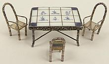 Antique Dutch Silver Miniature in the Form of a Tiled Table and 3 Chairs. Signed on Bottom Hand Painted Holland. Good Condition. Measures 3/4 Inch Tall. Shipping $25.00