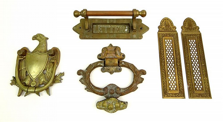 Collection of Miscellaneous Hardware Including Two (2) Brass Door Knockers, a Brass Letter Slot and a Pair of Brass Furniture Mounts. Unsigned. Used Condition. Letter Slot Measures 2-1/2 Inches Tall and 8-1/2 Inches Wide. Shipping $48.00
