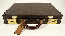 Vintage Louis Vuitton Monogram Hardside Canvas Attaché Case. Signed. Used Condition, Scuffs, Rubbing and Minor Splits to Lining. Please Examine this Lot Carefully Before Bidding. Measures 16-3/4 Inches Wide and 12-3/4 Inches Wide. Shipping $60.00