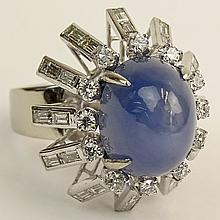 Retro Approx. 15.0 Carat Star Sapphire, 2.0 Carat Round and Baguette Cut Diamond and Platinum Ring.