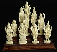 Ten (10) Indian Carved Ivory Deity Figures on Stepped Wood Base.