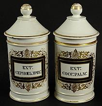 Two (2) 19/20th Century French H. Vignier, Paris Painted and Gilt Porcelain Covered Apothecary Jars. Signed. Chip to One Lid, Rubbing to Gilt Decoration Otherwise Good Antique Condition. Measure 11 Inches Tall and 5-1/4 Inches Wide. Shipping $78.00
