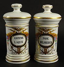 Two (2) 19/20th Century Painted and Gilt Porcelain Covered Apothecary Jars. Unsigned. Rubbing to Gilt Decoration Otherwise Good Condition. Measure 9-3/4 Inches Tall and 4-1/2 Inches Wide. Shipping $76.00