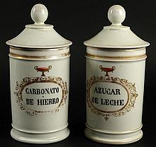 Two (2) 19/20th Century Painted and Gilt Porcelain Covered Apothecary Jars. Unsigned. Rubbing to Gilt Decoration Otherwise Good Condition. Measure 10 Inches Tall and 4-1/2 Inches Wide. Shipping $72.00