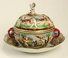 Antique Hand Decorated Figural Capodimonte Tureen with Lid and Underplate. Signed with Crown over N Mark. Good Condition with only Minor Edge Wear. Measures 7 Inches Tall, Underplate 8-1/2 Inches Diameter. Shipping $85.00