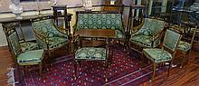 Early 20th Century Russian Empire style Gilt Bronze Mounted Karelian Birch Salon Set Including One (1) Small Sofa, Two (2) Arm Chairs, Four (4) Side Chairs, One (1) Bench, Two (2) Pedestals and One (1) Tea Table. Unsigned. Veneer Losses and Rubbing,