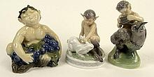 Lot of Three (3) Royal Copenhagen Porcelain Satyr Figurines in Various Poses. Signed with Royal Copenhagen Backstamp and Wave Mark. Good Condition. Measures 6-3/4 Inches. Shipping $55.00