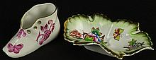 Two Vintage Herend Queen Victoria Porcelain Items. A Baby Shoe and A Leaf Dish. Shoe has Pink Design of Butterflies and Cherry Blossoms Impressed 7470 Measures 4 Inches long, 2-1/4 Inches Tall, 1-3/4 Inches Wide. Leaf Shaped Dish is Vibrant
