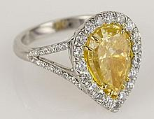 EGL Certified 4.0 Carat Pear Shape Fancy Yellow Diamond, Platinum and 18 Karat Yellow Gold Engagement Ring accented with .89 Carat Round Cut Diamonds. Yellow Diamond SI1 Clarity. Accent Diamonds F-G Color, VS1-VS2 Clarity. Signed Plat. 18K. Very Good