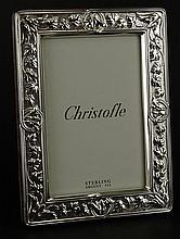 Christofle Sterling Silver Picture Frame. Vine and Leaf Design. Signed Christofle Sterling. Good Condition. Includes Partial Original Box. Measures 7-3/4 Inches by 5-3/4 Inches. Opening 5-1/2 Inches by 3-3/4 Inches. Shipping $45.00