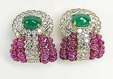 Lady's Bulgari style Cabochon Emerald, Ruby, approx. 5.0 Carat Round Cut Diamond and 18 Karat Yellow Gold Earrings. Emeralds Measure approx. 9mm x 7mm. Diamonds G-H Color, VS Clarity. Unsigned. Very Good Condition. Measure 1 Inch Tall and 7/8 Inch