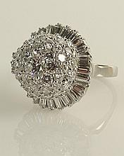 Lady's Diamond and Platinum Dinner Ring set with approx. .65 Center Round Cut Diamond and set throughout with approx. 5.50 Carat Round and Baguette Cut Diamond. Diamonds F-G Color, VS Clarity. Signed Plat. Very Good Condition. Ring Size 9. Approx.