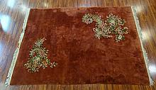 Semi Antique Chinese Wool Light Red Rug with Accented Corners of Flowers. Measures Overall 155 Inches Long with 5 Inch Fringe by 109-1/2 Inches Wide. Good Condition Stain in Middle Some soiling. We will not ship this item due to its size. We will