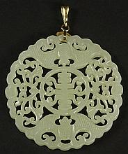 Chinese Openwork Carved White Jade and 14 Karat Yellow Gold Pendant with Longevity Symbol and Bats. Bale Marked 14K. Good Condition or Better. Measures 2 Inches Diameter. Shipping $34.00