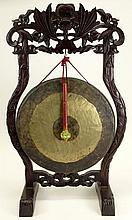 Antique Chinese Bronze Gong on Carved Hardwood Frame. Signed with Character Marks to Back. Wear, Rubbing, Patination or in Good Condition. Measures 36 Inches Tall, 21-1/2 Inches Wide. Gong Measures 18 Inches Diameter. We will not ship this item due