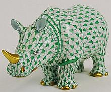 Herend Vintage Porcelain Rhinoceros Exotic Animal Green Fishnet  with Gold Accent. Very Good Condition. Signed in Blue Herend Hungry Hand painted on one Hoof. 147 on Other Hoof. Measures 5-1/2 Inches Long 2-3/4 Inches Tall. Shipping $45.00