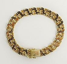 14 Karat Yellow Gold Double Link Bracelet. Signed Germany, 14K 585. Very Good Condition. Measures 7-1/2 Inches Long and 3/8 Inches Wide. Approx. Weight: 21.8 Pennyweights. Shipping $30.00