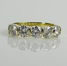 Approx. 2.50 Carat Round Cut Five (5) Diamond and 18 Karat Yellow Gold Band. Each Diamond approx. .50 Carat. Diamonds H-I Color, VS1-VS2 Clarity. Very Good Condition. Ring Size 7-1/2. Approx. Weight: 3.4 Pennyweights. Shipping $26.00