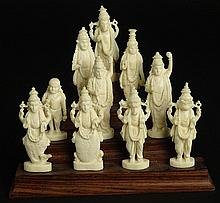 Ten (10) Indian Carved Ivory Deity Figures on Stepped Wood Base. Unsigned. Good Condition or Better. Each Figure Measures 2-3/8 Inches Tall. This item will only be shipped domestically and was legally imported into the United States. Shipping to
