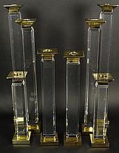 Charles Hollis Jones Eight (8) Piece Suite of Pedestal Style, Beveled Lucite and Brass Candlesticks. Circa 1975. Unsigned. Good Condition. Graduated Pairs Measure 22 Inches, 20 Inches, 15-1/2 Inches, 12 Inches Tall. Shipping $225.00
