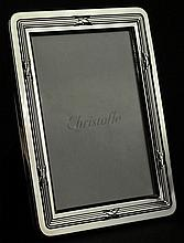Christofle Silver Plate Picture Frame in Original Box. Signed Christofle. Measures 6-3/4 Inches by 5-1/4 Inches. Holds a Photo 5 Inches by 3-1/2 Inches. Shipping $35.00