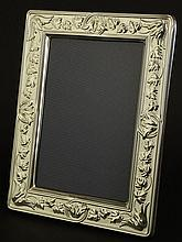 Christofle Sterling Silver Picture Frame. Vine and Leaf Motif. In original Box. Signed Christofle Sterling 925. Good Condition. Original Box Included. Measures 7-3/4 Inches by 5-3/4. Opening 5-3/4 Inches by 3-3/4 Inches. Shipping $35.00