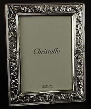 Christofle Sterling Silver Picture Frame. Vine and Leaf Design. Signed Christofle Sterling. Good Condition. Includes Original Anti-Tarnish Bag. Measures 9-1/2 Inches by 7-1/2 Inches. Opening 7 Inches by 5 Inches. Shipping $45.00