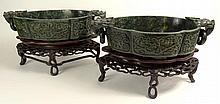Pair of Large Antique Chinese Carved Spinach Jade Wedding Bowls on Carved Hardwood Stands. Figural Ring Handles On Nicely Carved Lobed Bodies. Unsigned. Bowls are in Good Condition, The Bases have Losses. Each Measures 8-1/2 Inches on 4-3/4 Inch