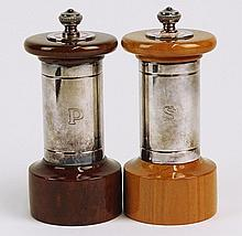 Peugeot Paris Salt and Pepper Mills. Silver Plate and Lacquered Wood. Signed. Good Condition or Better. Measures 4 Inches Tall Each. Shipping $45.00