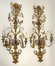 Pair Of Large Vintage Gilt Bronze and Carved Wood Three (3) Light Wall Sconces. Unsigned. Losses to Wood. Measures 49 Inches Tall, 20 Inched Width. We will not ship this item due to its size. We will happily recommend a list of outside vendors upon