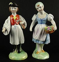 Two Vintage Herend Porcelain Hungarian Folk Peasant Figurines. A Boy with an Axe 5503 and a Girl with a Basket of Flowers 5502. Very Good Condition. Both Impressed with their Numbers and Herend. Each Measures Approximately 5-3/4 Inches Tall. Both