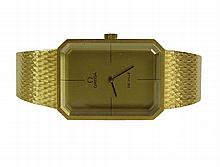 Men's Vintage Omega De Ville 18 Karat Yellow Gold Bracelet Watch. Clasp Signed 750. Good Condition. Appears to be in Running Condition. The Gallery does not Guaranty the Running Condition of Watches. Case Measures 32mm x 24mm. Bracelet Measures 7