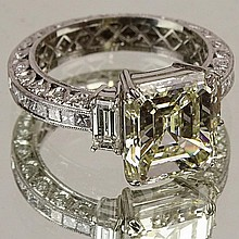 Lady's Very Fine Approx. 5.13 carat Emerald Cut Diamond and 18 Karat White Gold Engagement Ring. Diamond J-K color, VS2 clarity. Approx 1.50 carat gem quality accent stones F-G color, VS1 clarity. Unsigned. Very good condition. Ring size 6.