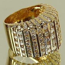 Lady's Approx. 4.25 Carat Round Cut Diamond and 18 Karat Yellow Gold Dinner Ring. Diamonds F-G color, VS clarity. Signed 18K. Very good condition. Ring size 6-1/2. Approx. weight: 8.50 pennyweights. Shipping $26.00