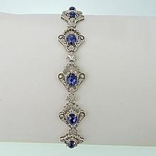 Lady's Edwardian style Approx. 15.0 Carat Oval Cut Sapphire, 4.0 Carat Round Cut Diamond and 18 Karat White Gold Bracelet. Sapphires with good saturation of color, diamonds F-G color, VS-SI clarity. Signed 750. Very good condition. Measures 7-1/4