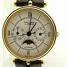 Vintage Van Cleef and Arpels 18 Karat Yellow Gold Moonphase Automatic Watch No.015 with Alligator Strap and 18K Buckle and with Box. Signed and numbered 118104 88787. Minor surface wear from normal use otherwise good condition. Strap worn. Appears to