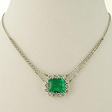Lady's Important Large Colombian Emerald, 2.0 Carat Diamond and 18 Karat White Gold Pendant Necklace. Emerald measures approx. 13mm x 11.5mm x 5.7mm. Emerald with Vivid Green Color. Diamonds F color, VS clarity. Clasp signed 750. Very good condition.