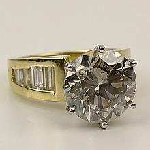 Lady's Approx. 5.0 Carat Round Brilliant Cut Diamond and 18 Karat Yellow Gold Ring. Diamond L-M-N color, SI1 clarity. Signed 18K. Very good condition. Ring size 5. Approx. weight: 6.50 pennyweights. Shipping $26.00