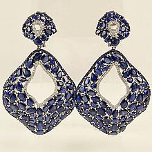 Lady's GGL Certified 53.82 Carat Mixed Cut Sapphire, .98 Carat Round Cut Diamond and 18 Karat White Gold Dangle Earrings. Sapphires with vivid saturation of color. Signed 18K. Very good condition. Measure 2-3/4 inches long and 1-1/2 inches wide.