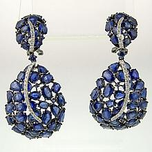 Pair of Lady's Approx. 30.0 Carat Multi Cut Sapphire, .50 Carat Diamond and 18 Karat White Gold Earrings. Sapphires with vivid saturation of color. Signed 18K 750. Very good condition. Measure 2 inches long and 1 inch wide. Approx. weight: 14.25