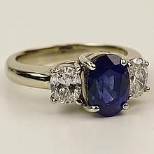 Lady's Approx. 2.86 Carat Oval Cut Natural Unheated Sapphire, .92 Carat Diamond and 18 Karat White Gold Ring. Sapphire with vivid color, VS clarity. Diamonds G-H color, VS1 clarity. Signed 18K DBS. Very good condition. Ring size 6-1/2. Approx.