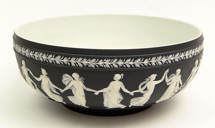 20th Century Black  Wedgwood Jasperware Bowl with White Overlay. Incised Wedgwood, Made in England and Letters. Has Small Flake on Side of Bowl or else Good Condition or Better. Measures 4-1/4 Inches Tall and 10 Inches Diameter. Shipping 59.00