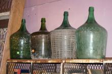 Lot of Four Green Glass Jugs