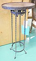 Wrought iron plant stand from the estate of Jose Thenee