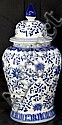 A BLUE AND WHITE ASIAN STYLE PORCELIAN JAR WITH LID