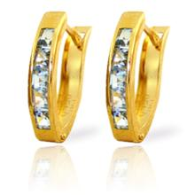 14K. SOLD GOLD OVAL HUGGIE EARRING WITH AQUAMARINES