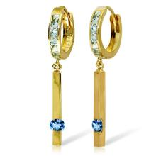 14K. GOLD HUGGIE EARRINGS W/ DANGLING BLUE TOPAZ