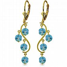 14K. GOLD CHANDELIERS EARRING WITH BLUE TOPAZ